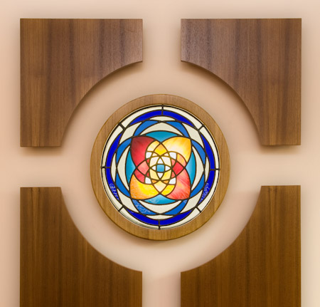 The stained glass feature and wood panelling is a focal point of the funeral home near where the coffin reposes.